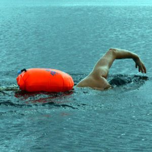 Swimmer with a tow float