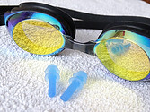 Swim goggles and ear plugs