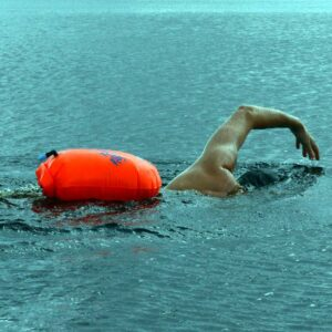 Swimmer using a Tow Float